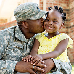 Military man with little girl