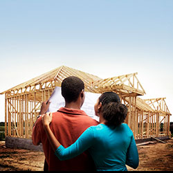 Young couple viewing new construction site