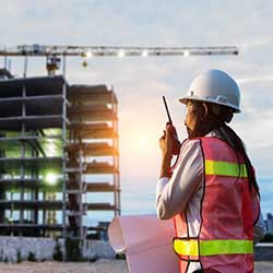 Worker in Hard Hat at Construction Site Commercial Loans