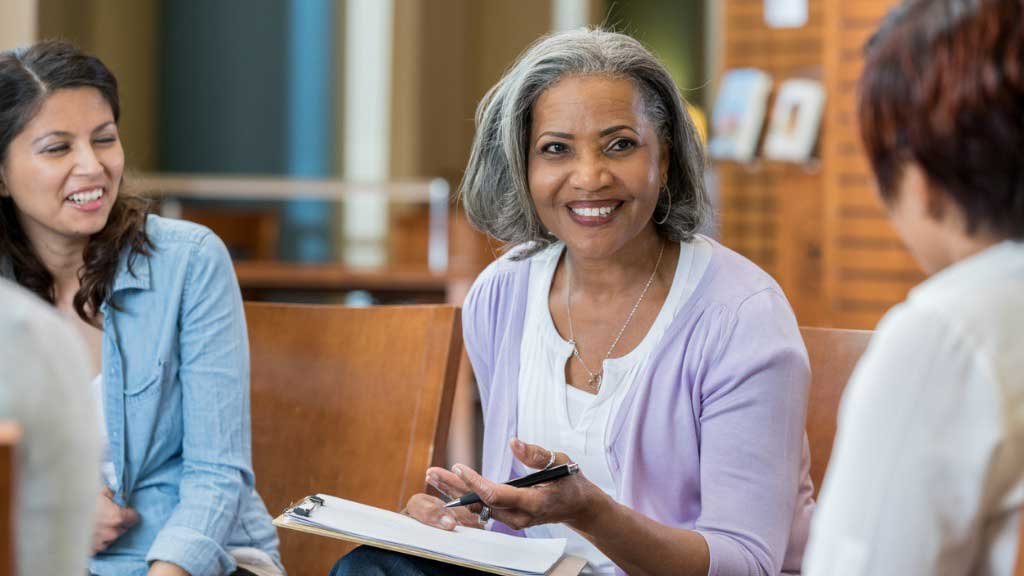 Senior african american female at university teaches in a casual setting Insurance